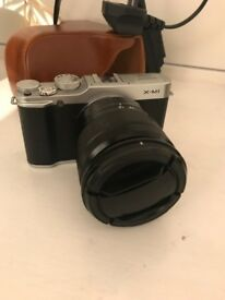 Fujifilm X-m1 with leather case, extra lens and memory card
