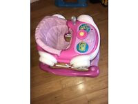 Baby walker pink good condition