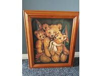 Picture or three toy bears with wood frame.