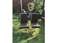 Pair of leather look dining chairs