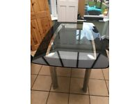 Glass table and 4 leather chairs