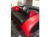 Designer red leather sofa and coffe table