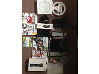 NINTENDO WII, 2xSteering wheels,2xNunchucks,2x Controllers,5 Games. £60 ONO Call me with offer