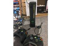 Xbox 360 elite in working order, 2 controllers & 6 games 120gb HDD