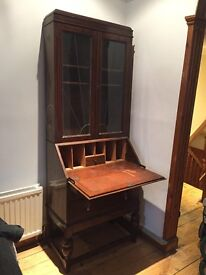 Antique wood bureau writing desk with drawers and shelves stained glass window