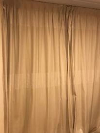 Beige lined floor length curtains