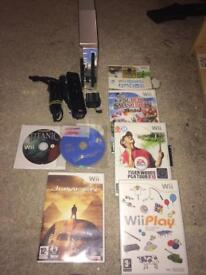 Silver Nintendo Wii and games