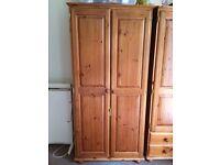 Solid pine two door wardrobe
