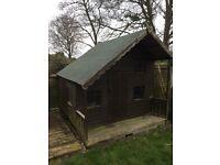 Wooden playhouse with Mezzanine deck inside and Veranda £100 o.n.o