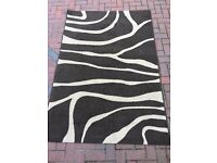Large brown and cream rug 195cm x 133cm