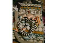 Baby's changing mat and cot mobile