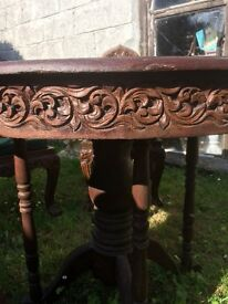 Vintage Indonesian table and chairs heavily carved hardwood