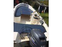 Kruger 14' inshore boat. 15 hp yamaha 4 stroke outboard. Power trim.
