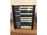 PlayStation 2 games and storage unit. Ps2
