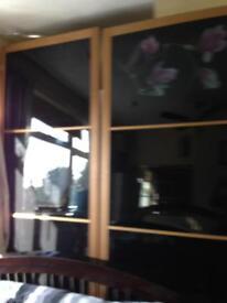 Sliding double wardrobe doors black glass mirror effect