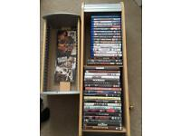18 bluray & 25 DVD's with storage rack