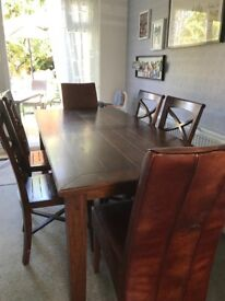 Sturdy dark wood table and 6 chairs for sale. Ex Collingwood Batchellor