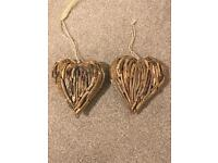 Two small driftwood wooden hearts
