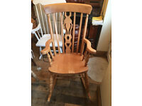 A SUPERB SOLID BEECH ROCKING CHAIR IN GREAT CONDITION WITH FIDDLE DESIGN TO THE CENTRE BACK