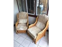 Two wicker/wooden armchairs