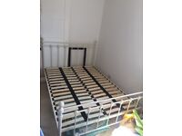 Ivory colour, double metal bed frame, delivery possible.