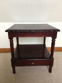 Dark mahogany wood side table with drawer