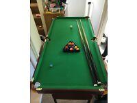 Fold away pool table