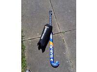Hockey stick and shin pads