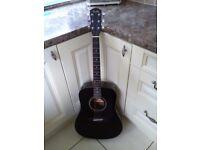 Fender Black Acoustic guitar.