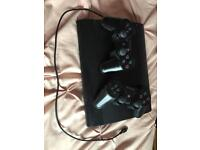PS3 with 2 controllers and charging cable