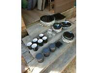 Job lot black plates, bowls, mugs and glasses