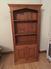 Solid waxed pine bookcase with cupboard