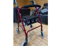 Folding 4 Wheeled Roma Medical Walker with brakes and bag