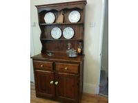 Beautiful solid wood dresser, two drawers and two cupboards. Ideal for rustic dining room or kitchen