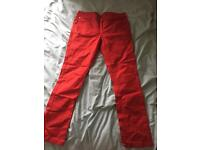 Red straight leg jeans