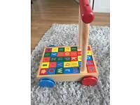 Walker with wooden blocks
