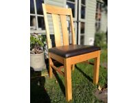 Four Oak dining chairs with Faux leather seats