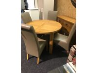 Solid oak extendable round table and four leather chairs