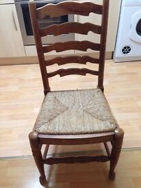 4 Solid Pine Dining Chairs , but 1 has seat missing.