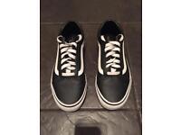 Black leather Vans shoes