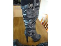 Black Leather Knee High Boots in size 8.