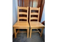 2 solid oak dining chairs