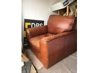 Brown leather single seat sofa chair