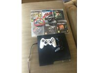 PS3 with two controllers and 6 games