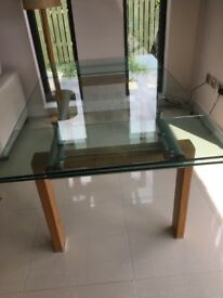 Extending glass dining room table in excellent condition.