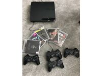 PS3+4Controllers+5 Games Very Good Condition