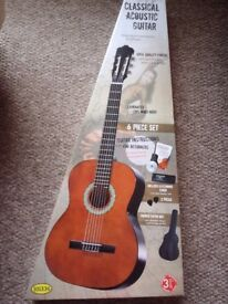 Brand new boxed classical acoustic guitar with bag, electronic tuner, 2 picks, book & CD