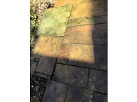£20 - Approximately 10 square mtrs of mixed size patio slabs; been in use for a number of years