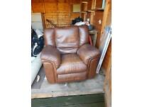 Single brown leather recliner sofa