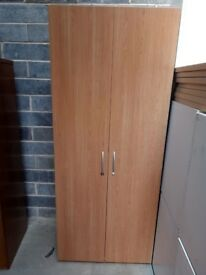 Tall wooden cupboards in beech with grey steekl sides